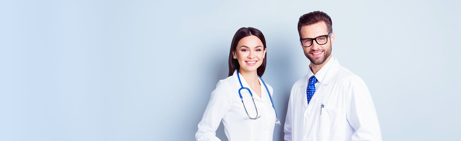 portrait of male doctor and female nurse