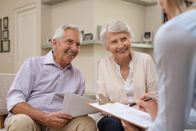 senior couple talking to insurance agent