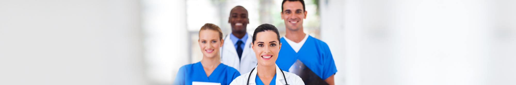nurses and doctor smiling